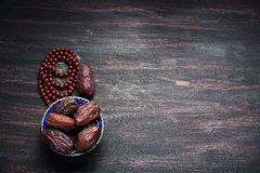 Dates fruit and rosary still life royalty free stock photos