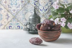 Dates fruit and rosary still life. stock images