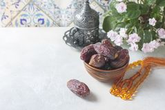 Dates fruit and rosary still life. stock photos