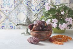 Dates fruit and rosary still life. stock image