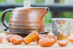Dates fruit with tea cup Royalty Free Stock Photos