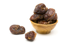 Dates fruit in a wooden bowl Royalty Free Stock Photo