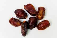 Dates fruits  on white background. Top view close up details. stock photo