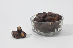 Dates in glass cup Stock Photo