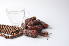 A dates and glass of water - the things used to break the fast at sunset during the Muslim holy month of Ramadan. Stock Photo
