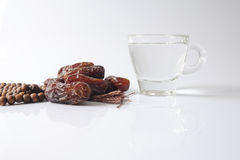 A dates and glass of water - the things used to break the fast at sunset during the Muslim holy month of Ramadan kareem Stock Photos
