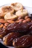 Dates, hazelnuts, almonds, fig Stock Photos