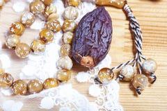 Dates  with islamic rosary. Stock Photo
