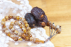 Dates  with islamic rosary. Royalty Free Stock Images