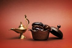 Dates and lamp aladdin. On a dark background stock image