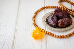 Dates on metal plate as iftar food during Ramadan month. Stock Photos