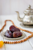 Dates on metal plate as iftar food during Ramadan month. Stock Photo