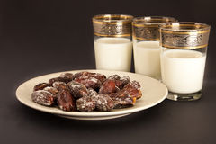 Dates and milk. Fresh dates and milk typically used to break the ramadan fast Royalty Free Stock Photography