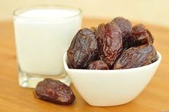 Dates and milk. Stock Photos