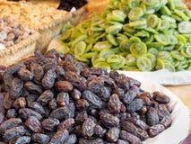 Dates, next to candied kiwi fruit. stock photo