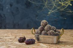 Dates and oatmeal energy balls or bites no cook royalty free stock photo