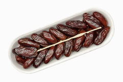 Dates in the package. On white background isolated Stock Photography