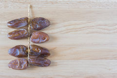 Dates palm on the wooden Stock Photo