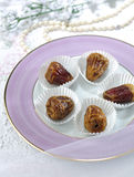 Dates in paper cup Stock Photo