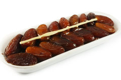 Dates in plastic wrap. On a white background Stock Images