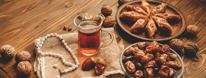 Dates, rosaries and baklava. Ramadan. Selective focus royalty free stock photo