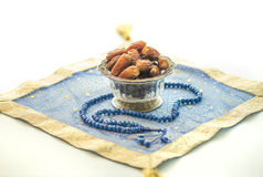 Dates and rosary. Bowl of dates and islamic rosary Stock Photos
