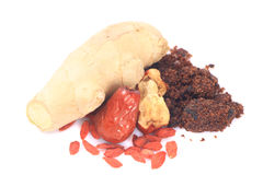 Dates rouges, wolfberry chinois, sucre roux, gingembre Photographie stock libre de droits