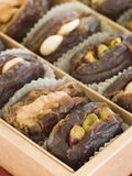 Dates stuffed with Nuts and Marzipan. Close up Dates stuffed with Nuts and Marzipan stock photos