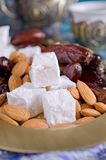 Dates, sweets and nuts Stock Photo