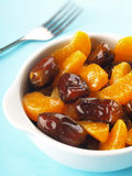 Dates and tangerine fruit salad Royalty Free Stock Photo