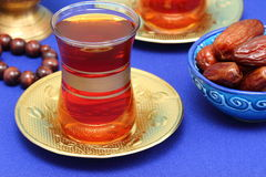 Dates and tea for Ramadan. Arabic tea, rosary and dates Royalty Free Stock Photo