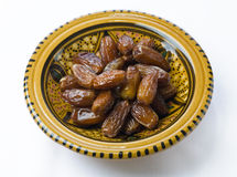 Dates in a traditional bowl stock photo