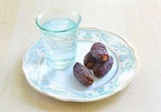 Dates and water Royalty Free Stock Photos