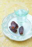Dates and water Royalty Free Stock Photo