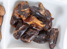 Dates in a white dish Stock Photo
