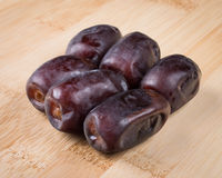 Dates. On a wooden cutting board Royalty Free Stock Image