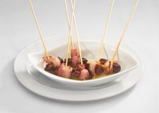Dates wrapped in bacon Royalty Free Stock Photography