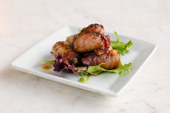 Dates  wrapped in Bacon and blue cheese. Spicy Royalty Free Stock Photos