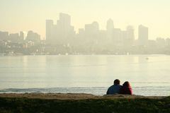 Dating. A dating couple enjoying sunset and downtown view Stock Images