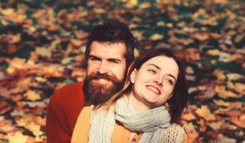 Dating and autumn love concept. Girl and bearded guy. Or happy lovers on a date hug. Man and women with cheerful faces on nature background. Couple in love with royalty free stock photo