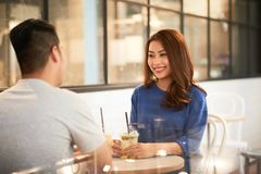 Dating. Beautiful young Asian women dating with her boyfriend in cafe royalty free stock photos
