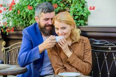 Dating businessman. Couple cuddling cafe terrace. Couple in love sit cafe terrace enjoy coffee. Things know before you. Date businessman. Find and date stock photo
