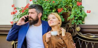 Dating businessman. Couple in love sit cafe terrace enjoy coffee while man speak phone. Girl dating with businessman. Things know before you date entrepreneur stock images