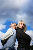 Dating couple. In love outdoors over sky royalty free stock images