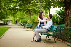 Dating couple on a bench in a Parisian park Stock Photography