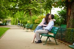 Dating couple on a bench in a Parisian park Royalty Free Stock Photography