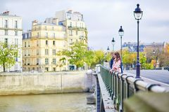 Dating couple on a bridge in Paris Stock Photos
