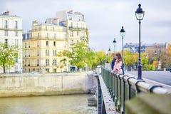 Dating couple on a bridge in Paris Stock Photos