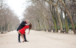 Dating couple dancing in a Parisian park Royalty Free Stock Photography