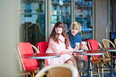 Dating couple drinking coffee in a Parisian cafe Stock Photography